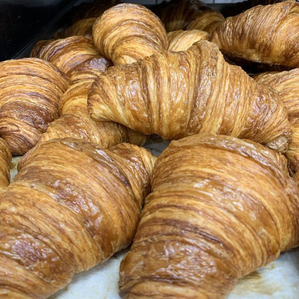 A pile of croissants on a tray