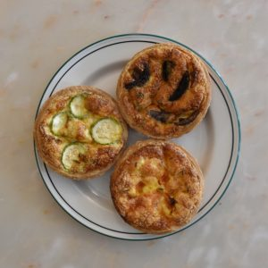 3 quiches on a plate