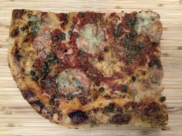 picture of focaccia with capers and cheese