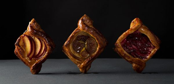 3 pastries standing upright